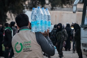 Drinking water being provided by Syrian Forum's Ihsan Organization