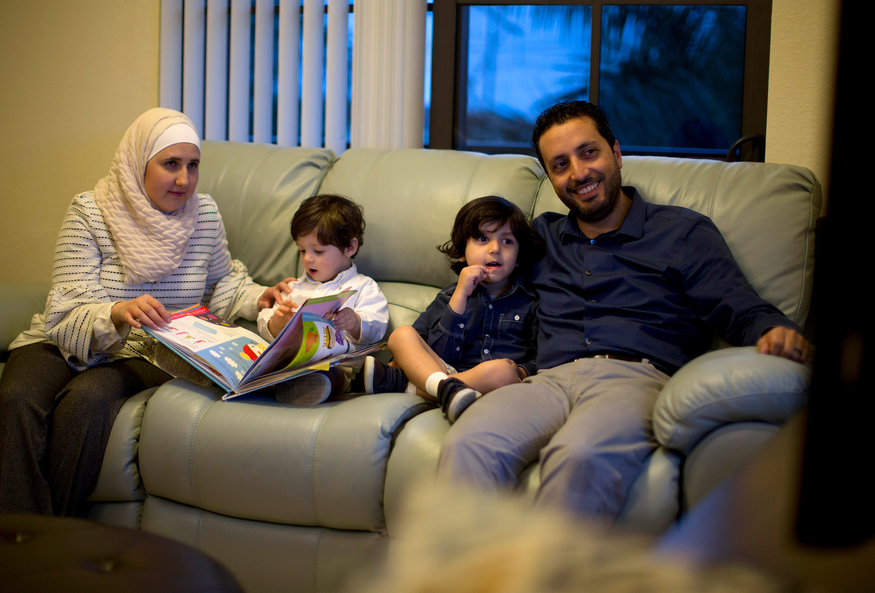 Mohammad at home with his family